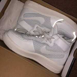 White high top women's nike's. worn once !!